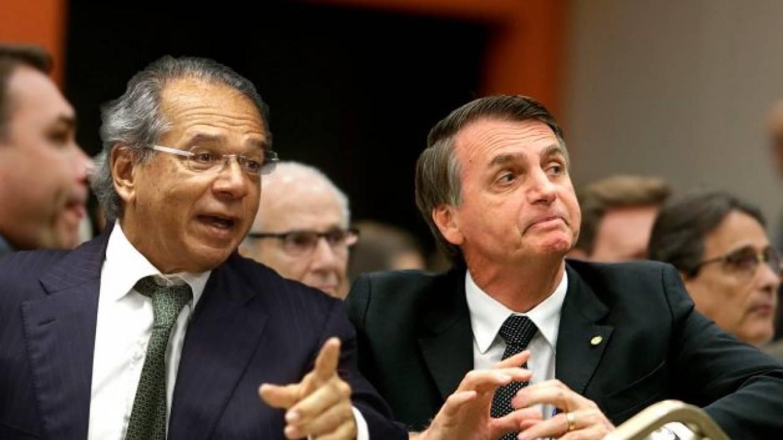 Nos EUA, ao lado de Bolsonaro, Guedes fala em fusão entre BB e Bank of America